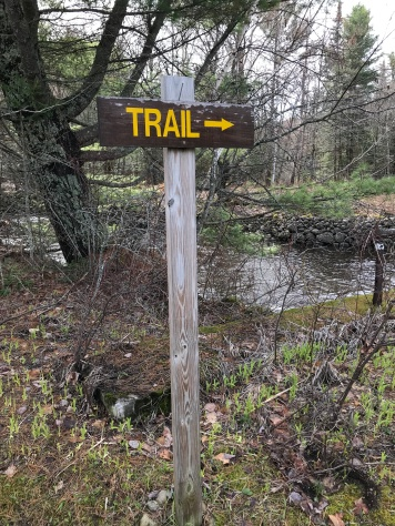 St Regis trail sign with arrow